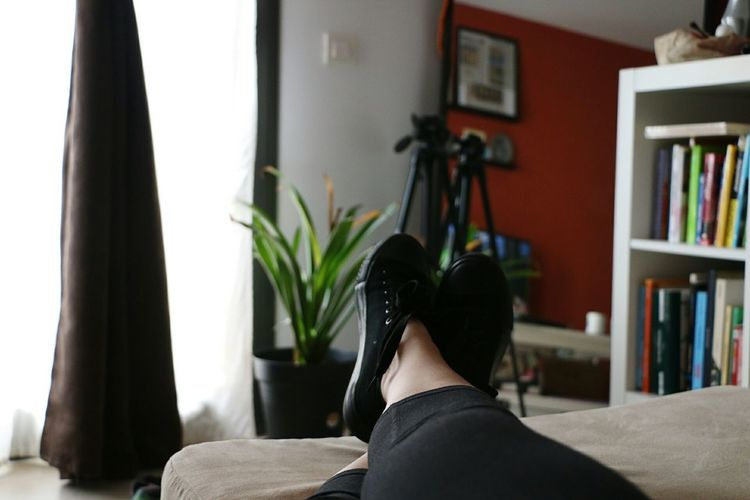 Low section of woman relaxing at home