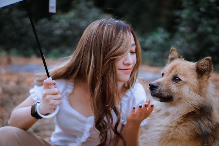 Close-up of woman with dog
