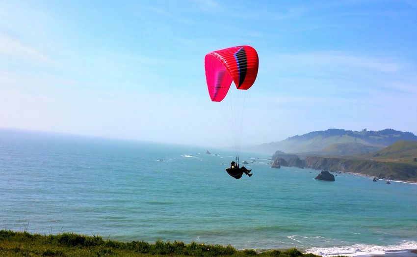 Up Above the Earth So High! Experience Risktaker Red Kite Blue Sky Zen Background Copy Space Timeless Meditation Dangerous Moment Flying Sport Cliffs Thrill Water Paragliding Flying Sea Beach Mid-air Red Mountain Sky Horizon Over Water Ocean Calm Seascape Summer Exploratorium