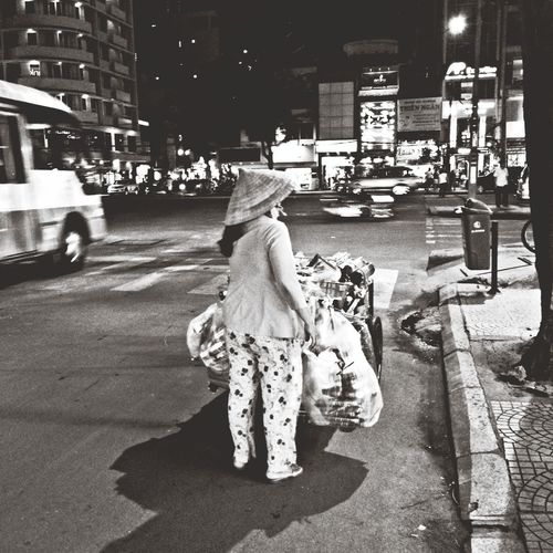 Full length of woman in city at night