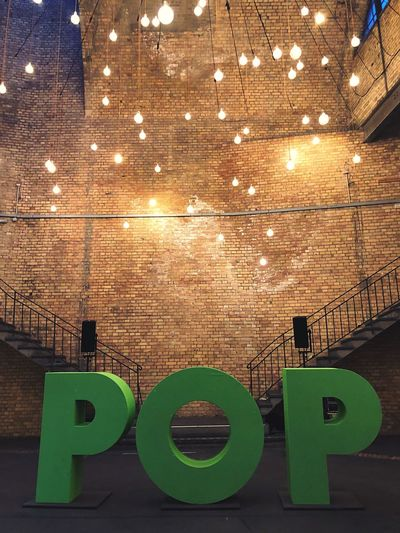 POP #rp18 Stairs Stationberlin Lightbulb Light Design Typography Berlin Re:publica #rp18 Pop Illuminated Built Structure Architecture Lighting Equipment No People Indoors  Communication Green Color Text Glowing Decoration Ceiling Hanging Arrangement