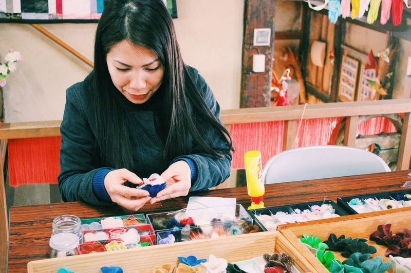 Woman holding craft product at shop for sale