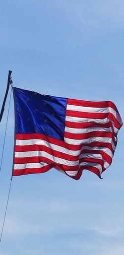 Stars And Stripes Flying Blue Red Patriotism Flag Pride Wind Cultures Freedom Fluttering City Location Symbolism National Flag National Icon Identity Pole Flag Pole Citizenship Star Shape Politics And Government