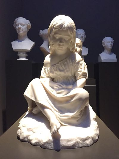 Sadness And Sorrow Sadgirl Human Representation sad girl holding a dead bird. This sculpture transports me faraway Art And Craft Sculpture Statue Indoors  No People Creativity Close-up Light And Shadow Sorrow Girl Dead Museum