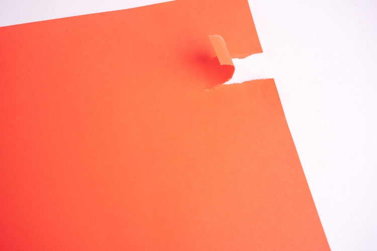 Torn paper style, hand peels paper. Red Copy Space Indoors  Close-up Studio Shot Torn Paper Paper Torn White Red No People Wall - Building Feature Architecture Built Structure Orange Color White Background White Color Backgrounds Full Frame Blank Pink Color Shadow Day Wall