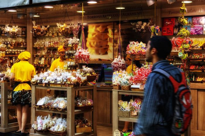 Candy shop Retail  For Sale Store Selling Small Business Variation Choice Sweet Food Real People Consumerism Business Customer  Dessert Young Women Market Two People Young Adult