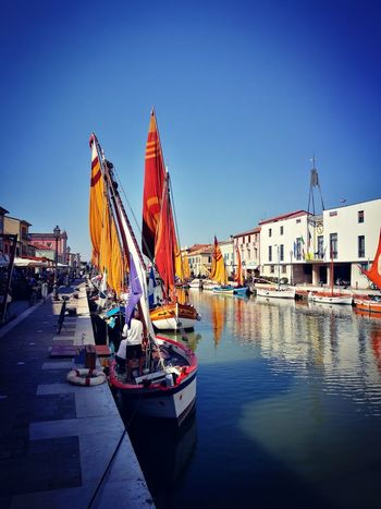 Reflection Blue Travel Destinations Nautical Vessel Flag Outdoors Summer Sea Sky No People Vacations Water Day City Politics And GovernmentI Gondola - Traditional Boat