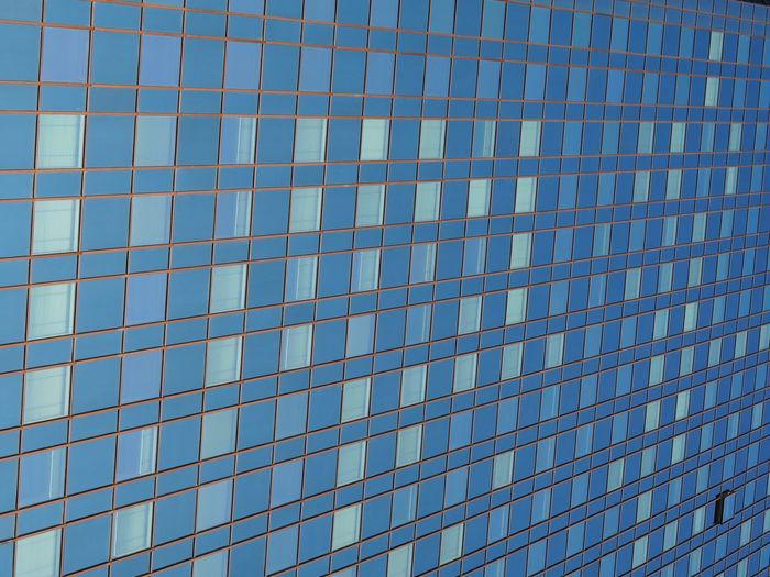Full frame shot of modern building against blue sky