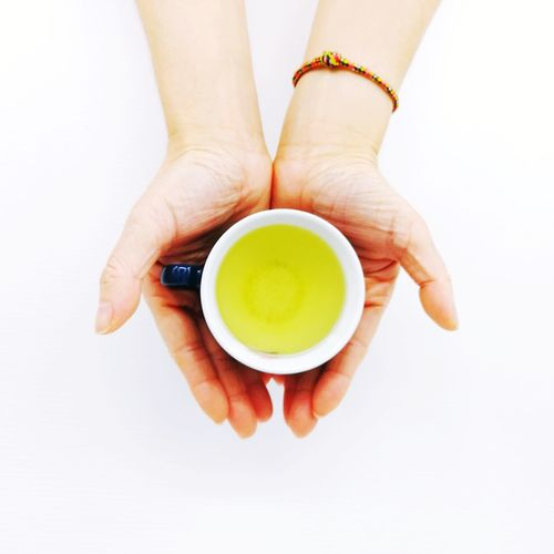 EyeEm Selects Human Hand White Background Studio Shot Close-up Food And Drink Japanese Tea Cup Green Tea Tea Cup Tea - Hot Drink Tea Matcha Tea Herbal Tea Afternoon Tea Black Tea Mint Tea Teapot Tea Leaves Chinese Tea Ground Coffee Tea Ceremony