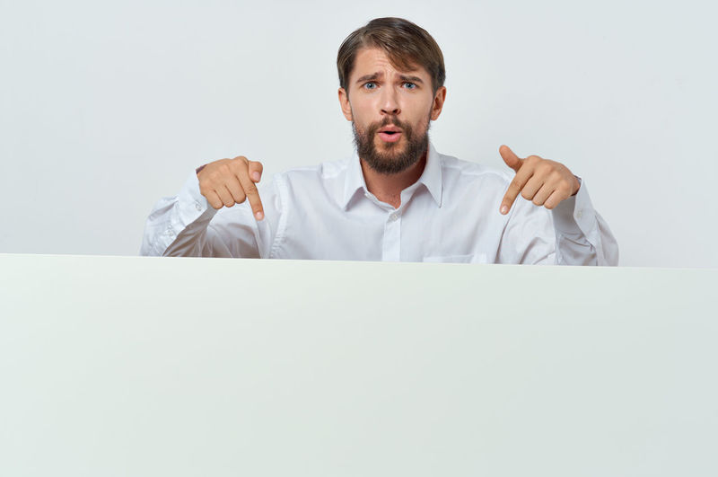 Portrait of a serious young man over white background