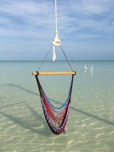 Close-Up Of Hammock Hanging Over Sea