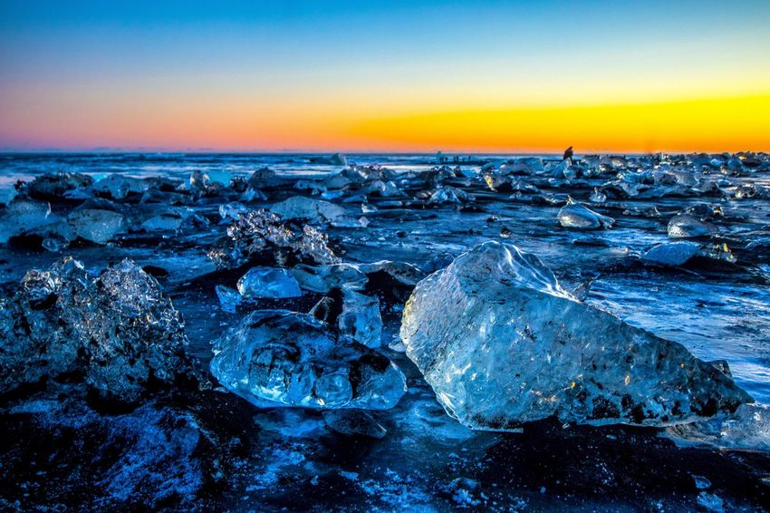 Diamond Beach Jökulsárlón Glacier Lagoon Iceland Landscape_Collection Landscape The Week On EyeEm Iceland Jökulsárlón Beach Jökulsárlón Glaciar Lagoon Jökulsárlón Diamond Beach Travel Photography Travel Destinations Sea Tranquility Beauty In Nature Tranquil Scene Nature Water Scenics Blue Beach No People Horizon Over Water Sunset Outdoors Sky Clear Sky Day Pebble Beach