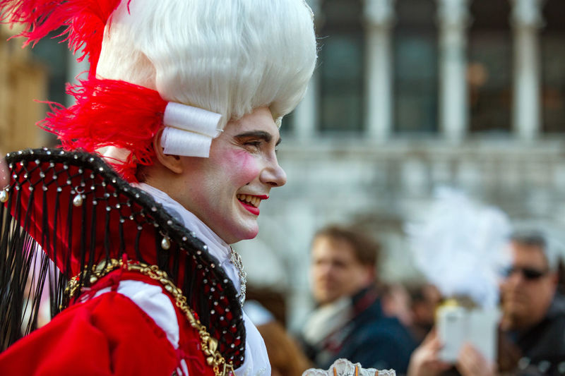 Carnival Carnival In Venice Venice, Italy Adult Adults Only Beautiful Woman Blond Hair Carnival Costumes Cheerful Close-up Day Focus On Foreground Happiness Headshot Leisure Activity Lifestyles Mask One Person Outdoors People Real People Red Smiling Traditional Clothing Venetian Mask Young Adult