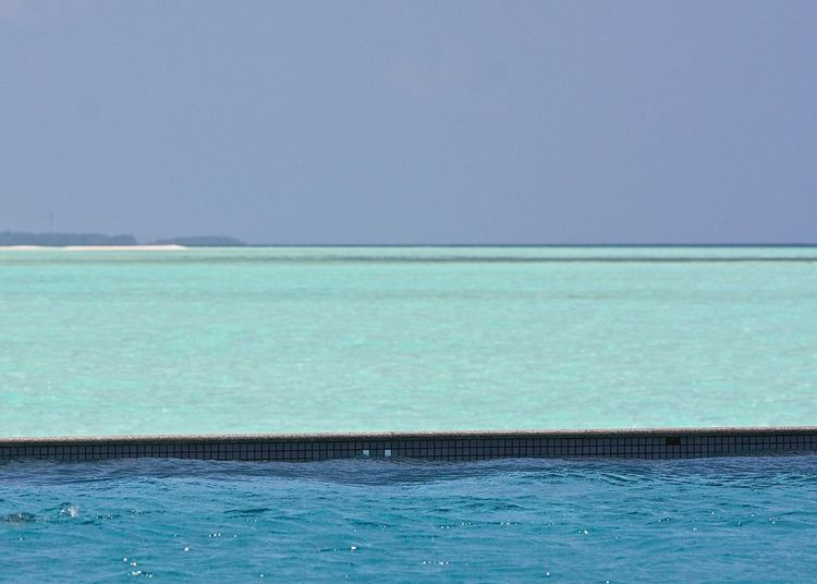 View Of Infinity Pool And Sea Against Clear Sky