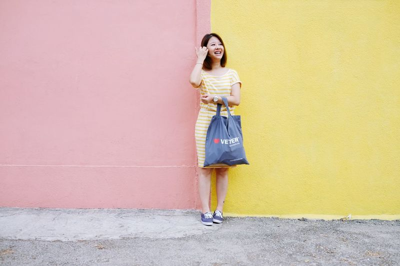 Nature_collection Pink Colorful Ihaveathingforwalls EyeEm Selects Full Length One Person Standing Casual Clothing Wall - Building Feature Lifestyles Yellow Hairstyle Leisure Activity Happiness Beautiful Woman Front View