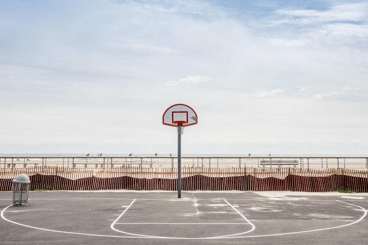 Basketball court against cloudy sky