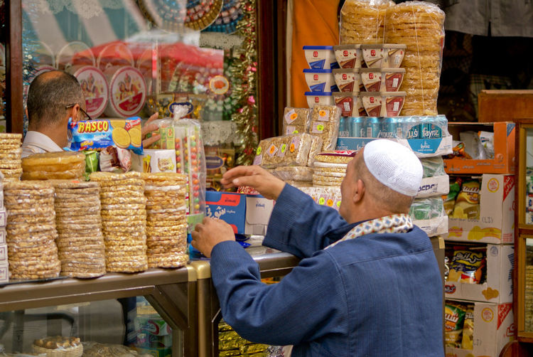 Man packing products in shop