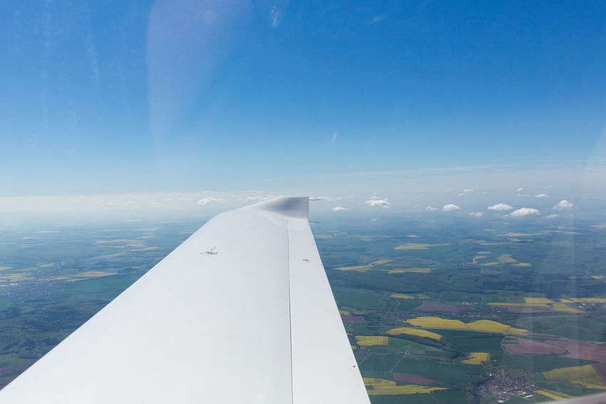 Aerial View Air Vehicle Aircraft Wing Airplane Beauty In Nature Blue Cloud - Sky Day Environment Flying Landscape Mid-air Mode Of Transportation Motion Nature No People Outdoors Scenics - Nature Sky Transportation Travel