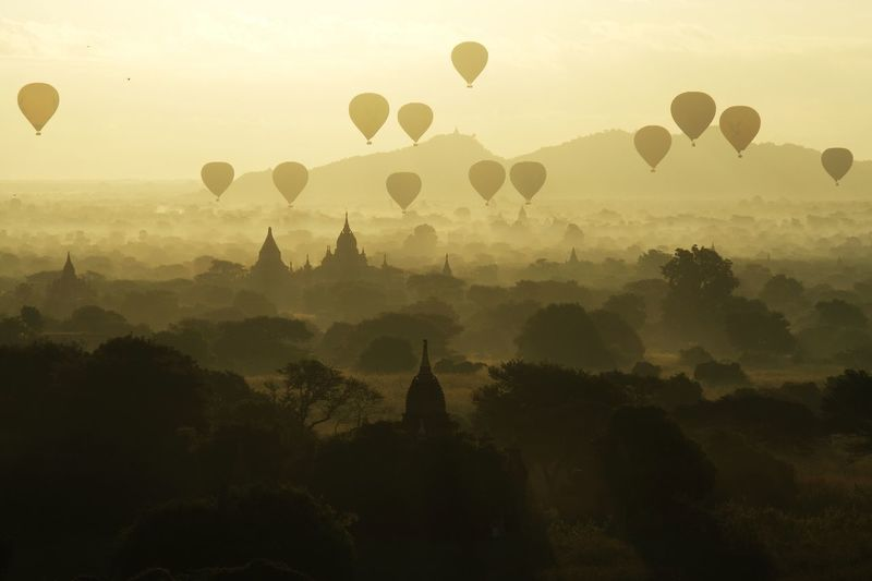 Hot Air Balloon Religion Place Of Worship Pagoda Travel Sky Architecture Sunset Ancient Silhouette Nature Landscape Tree Beauty In Nature Outdoors Built Structure Balloon Flying Mountain EyeEm Best Shots EyeEm Gallery Check This Out Popular Photos in Bagan , Myanmar MISSIONS: The Architect - 2017 EyeEm Awards The Great Outdoors - 2017 EyeEm Awards The Photojournalist - 2017 EyeEm Awards Neon Life The Traveler - 2018 EyeEm Awards The Great Outdoors - 2018 EyeEm Awards The Architect - 2018 EyeEm Awards Capture Tomorrow