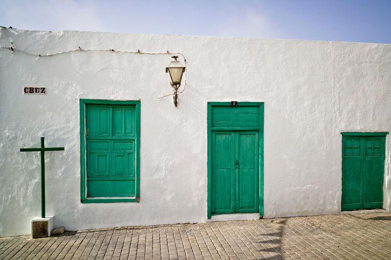 green doors Spain🇪🇸 Canary Islands Cross Symbol House Lanzarote Green Door House Architecture Building Exterior Built Structure Closed Door Entrance