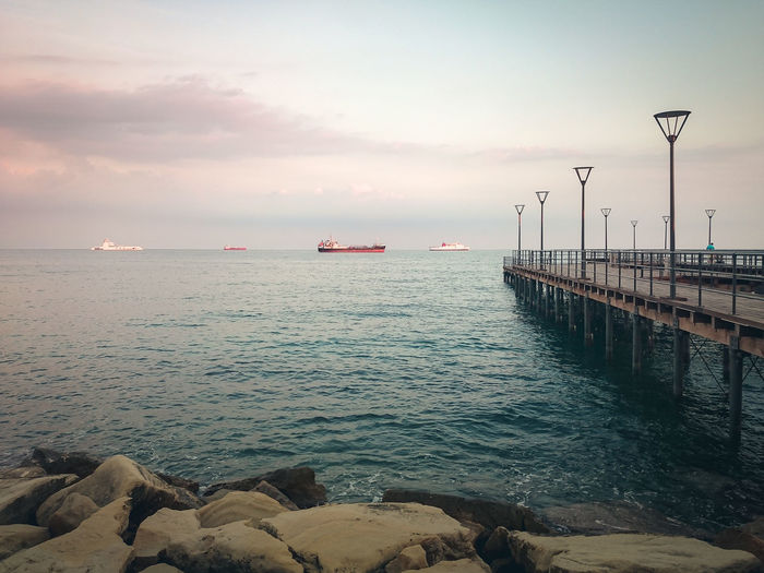 Beach Beauty In Nature Blue Hour Cloud - Sky Day Horizon Over Water Nature Nautical Vessel No People Outdoors Scenics Sea Seafront Sky Sunset Tranquil Scene Tranquility Transportation Water Copy Space The Great Outdoors - 2017 EyeEm Awards