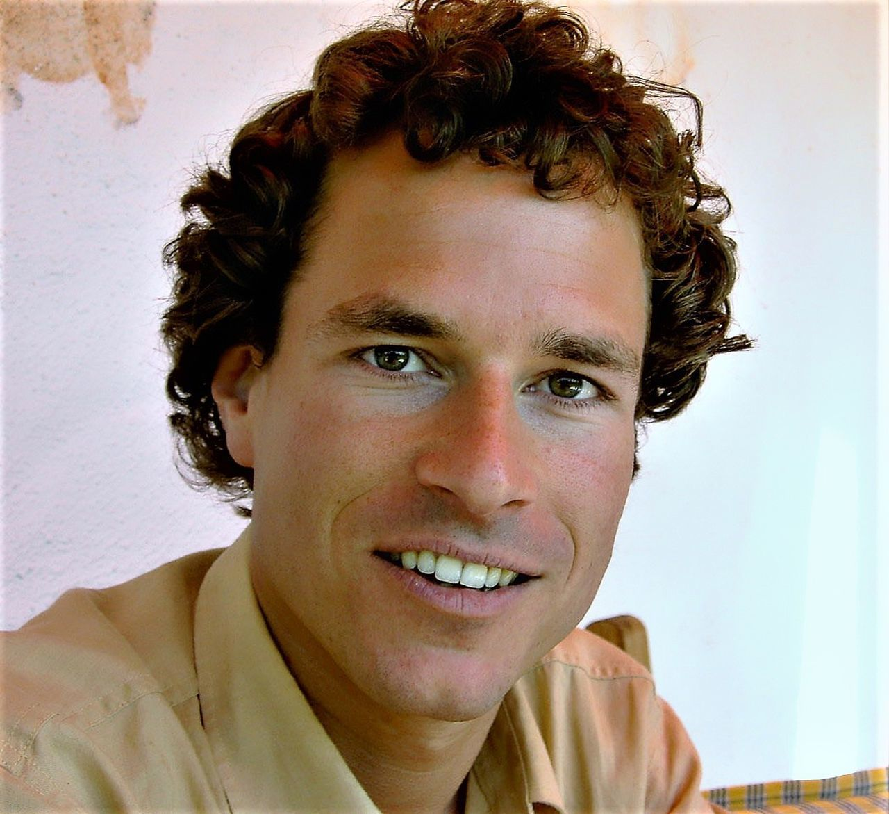 PORTRAIT OF SMILING MAN AT HOME