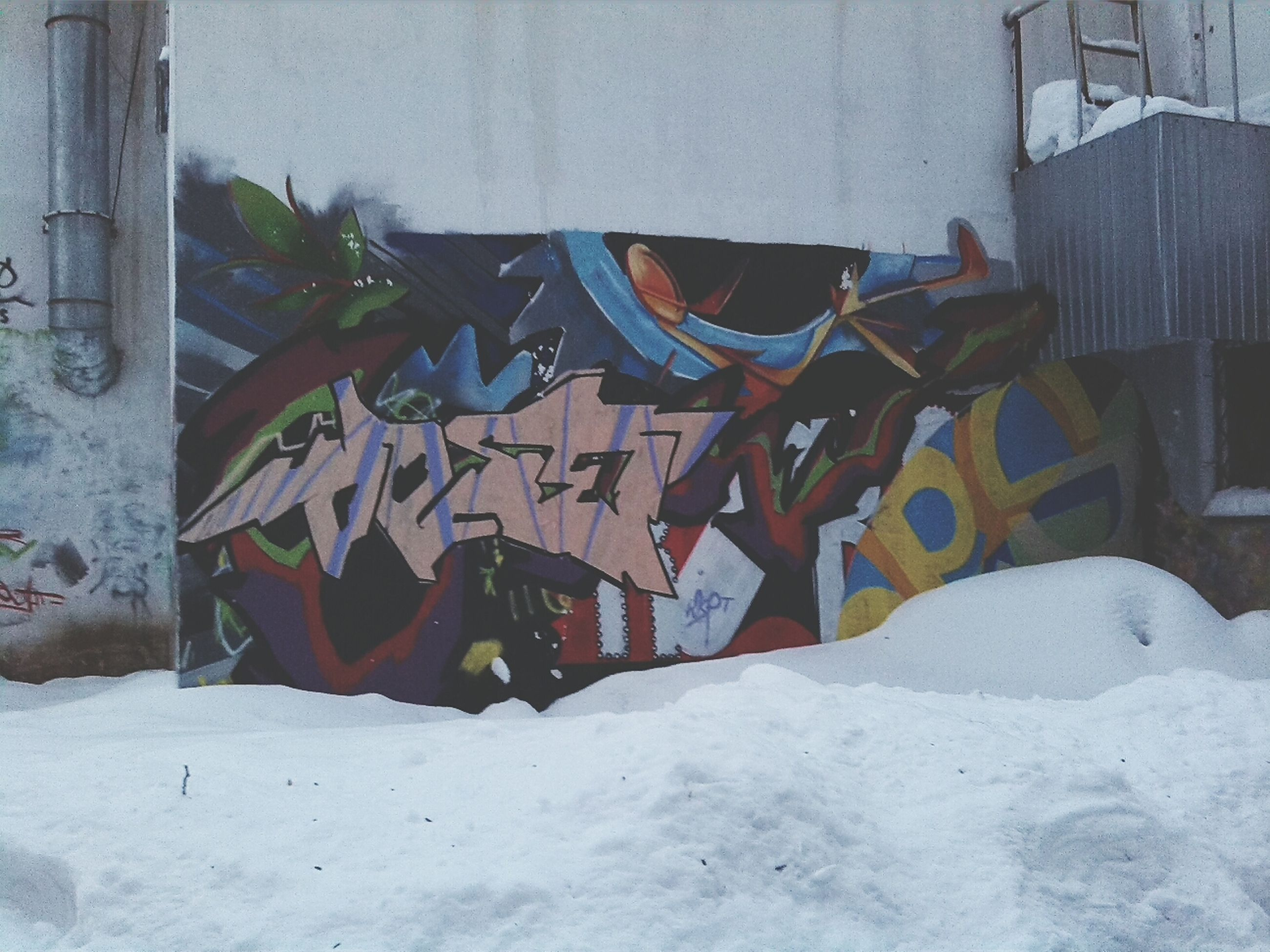 snow, winter, architecture, built structure, cold temperature, building exterior, covering, house, wall - building feature, season, white color, weather, day, graffiti, no people, outdoors, covered, field, nature, wall