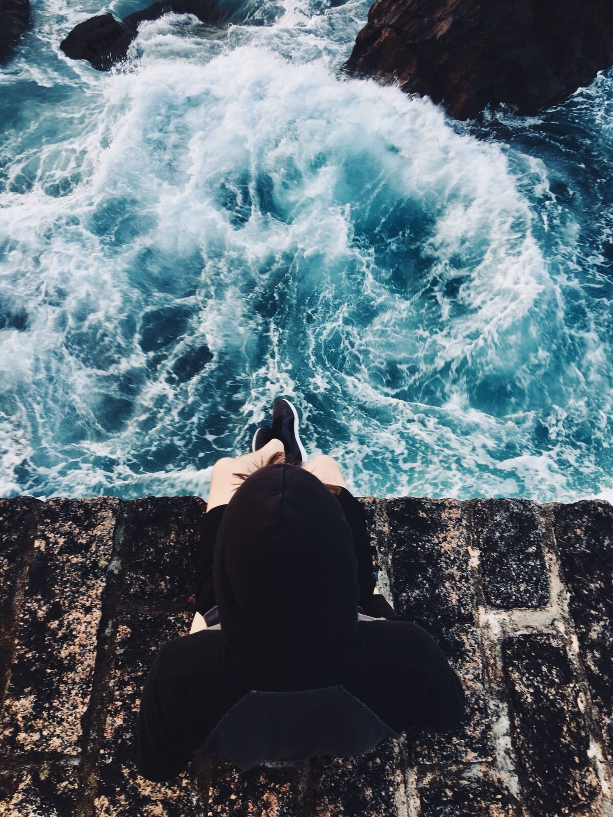water, sea, one person, real people, rear view, motion, leisure activity, sitting, lifestyles, nature, sport, wave, surfing, relaxation, rock, solid, aquatic sport, day, outdoors, flowing water, power in nature