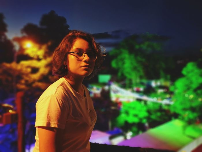 Portrait of teenage girl at night