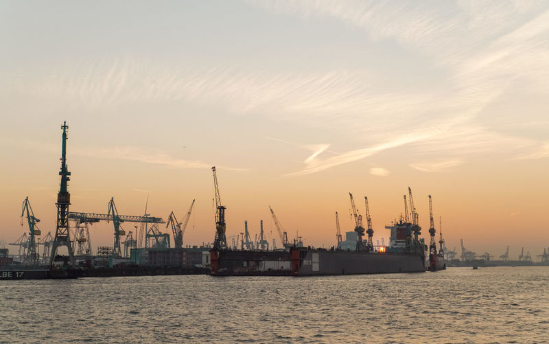 Port of Hamburg loading docks and sunset panorama Sky Water River Port Loading Dock Panorama Sunset Pier Machinery Crane - Construction Machinery No People Harbor Outdoors Waterfront Freight Transportation Industry Nautical Vessel Commercial Dock