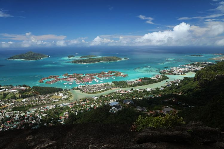 Panoramic view of sea and city against sky