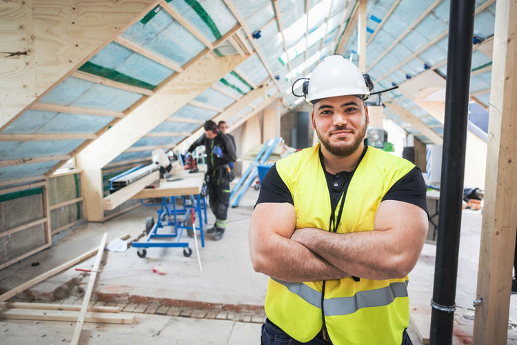 Portrait of young man at construction site