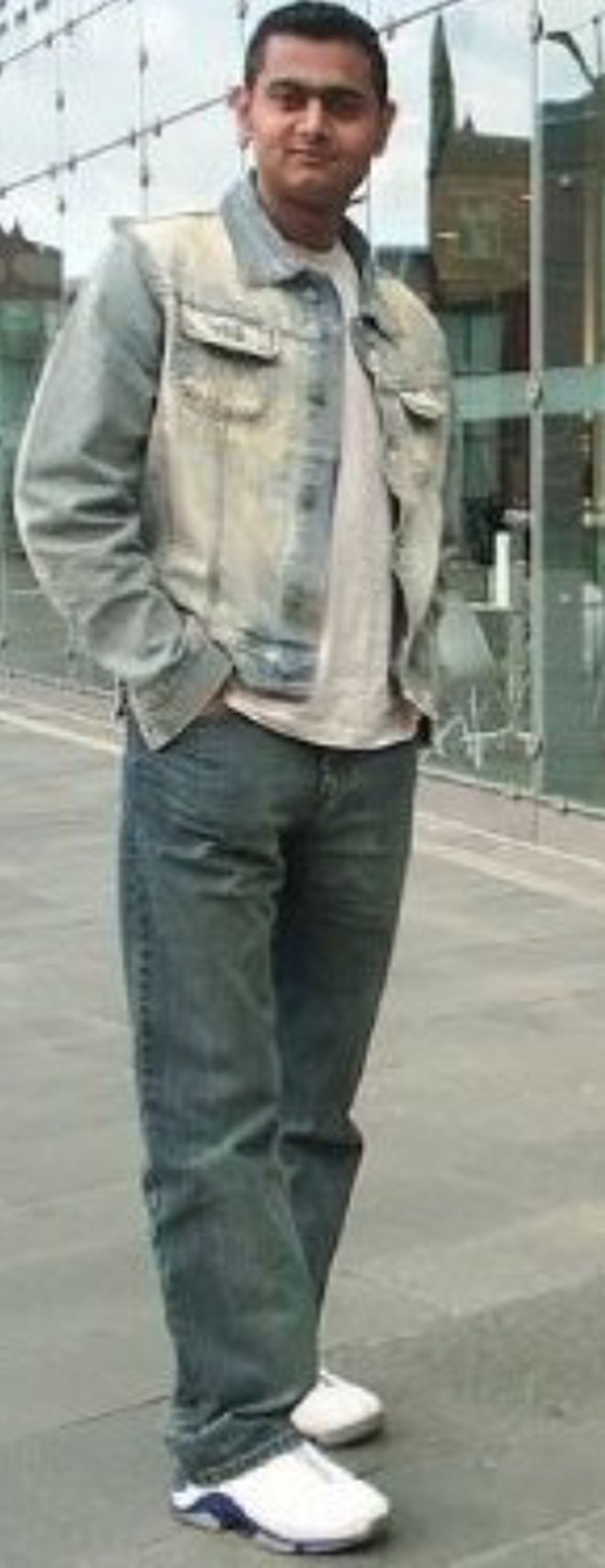 casual clothing, lifestyles, standing, person, full length, young adult, front view, leisure activity, jacket, three quarter length, young men, warm clothing, built structure, architecture, jeans, focus on foreground, holding, hands in pockets