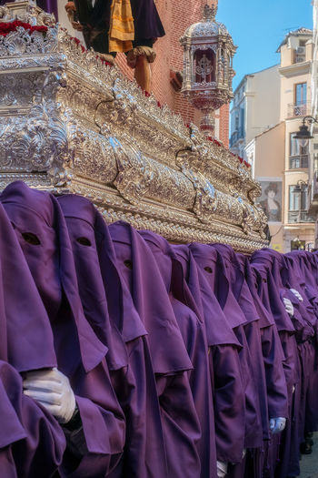 People in the procession in the Holy Week (Semana Santa) in a Spanish city. Malaga, Spain - March 26, 2018. Catolic Church Children Easter Easter Ready Historical Building Holy Week Malaga People Watching SPAIN Semana Santa Spanish Uniform Uniforms Architecture Arrangement Blue Building Exterior Built Structure Business Catolicism Celebration Choice Clothing Day España For Sale Incidental People Large Group Of Objects Musical Instrument Musician Musician Bands Old Buildings Outdoors People Procession Purple Real People Retail  Retail Display Sabor Small Business Spain Is Different Spanish Arquitecture Spanish Culture Textile The Street Photographer - 2018 EyeEm Awards The Traveler - 2018 EyeEm Awards