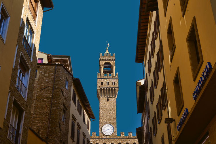 Palazzo Vecchio Firenze Travel Architecture Bell Tower Blue Building Exterior Built Structure City Clear Sky Clock Clock Tower Day Florence Italy Low Angle View No People Outdoors Place Of Worship Religion Sky Spirituality Travel Destinations