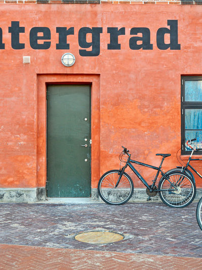 b a u h a u s Outdoors Travel Travel Destinations Copenhagen Copenhagen, Denmark Wandering Built Structure Building Exterior Architecture Architecture_collection Architectural Feature Architectural Detail Architecturelovers Old Colors Colorful Wall - Building Feature Wall Red Red Color Scenery Street Streetphotography Bike Typography Word City Cityscape City Life Man Made Object Man Made Man Made Structure LINE Lines Lines And Shapes Geometric Shape Geometry Door Doorway Bicycle Text Transportation Entrance Western Script Day Communication Mode Of Transportation No People Land Vehicle Stationary Window Building Brick The Traveler - 2019 EyeEm Awards The Architect - 2019 EyeEm Awards My Best Photo