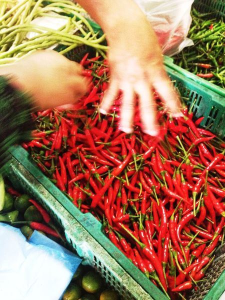 First come first serve. Grabbing Red Chillis at Wet Market