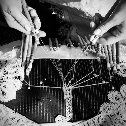 Cropped image of man making machine