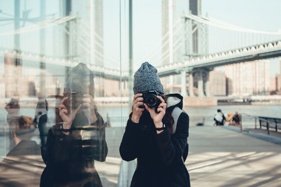 Architecture Bridge - Man Made Structure Built Structure Camera - Photographic Equipment Close-up Day Digital Camera Focus On Foreground Holding Leisure Activity Men Modern Outdoors People Photographer Photographing Photography Themes Real People Technology Two People Young Adult