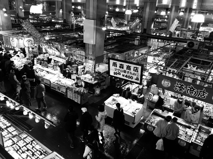High angle view of people in market at night