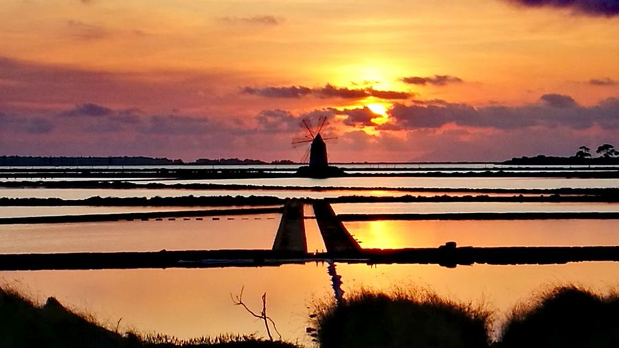Sunset Reflection Orange Color Silhouette Water Sky Nature Tranquility Beauty In Nature Outdoors Agriculture Scenics Sea Landscape No People Horizon Over Water Day Windmill Silhouette