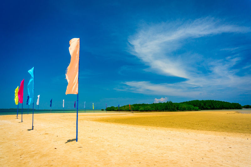 Luli Island @Puerto Princesa EyeEmNewHere Beachphotography Palawan Sand Flag Blue Sky Blue Landscape Beach Blue Sky Cloud - Sky Sand Arid Landscape FootPrint Shore Summer Exploratorium