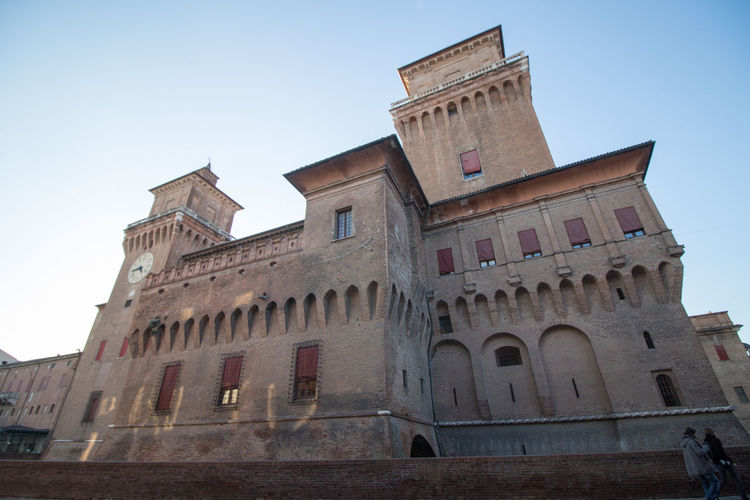 Low angle view of castello estense against sky