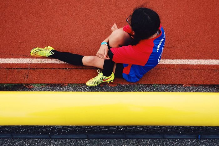 The Photojournalist - 2017 EyeEm Awards Sports Track Yellow Red ...stretching between soccer games.