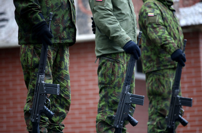 Midsection Of Men With Weapons In Camouflage Clothing