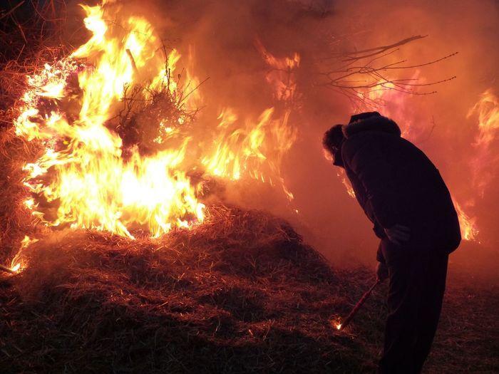 Man Burning Hay At Night