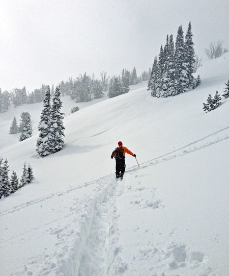 Man walking on snow covered mountain
