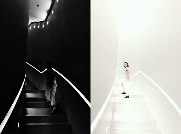 Low angle view of woman walking on staircase