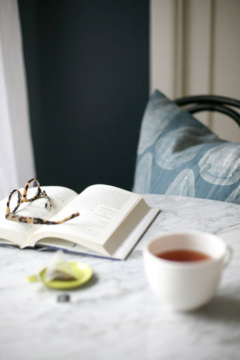 Lifestyle Morning Reading Relaxing Still Life Photography Tea Book Coffee - Drink Coffee Cup Drink Home Interior Indoors  Lifestyles Morning Rituals No People Refreshment Relax Relaxation Relaxing Moments Relaxing Time Slow Life Still Life Table Tea - Hot Drink