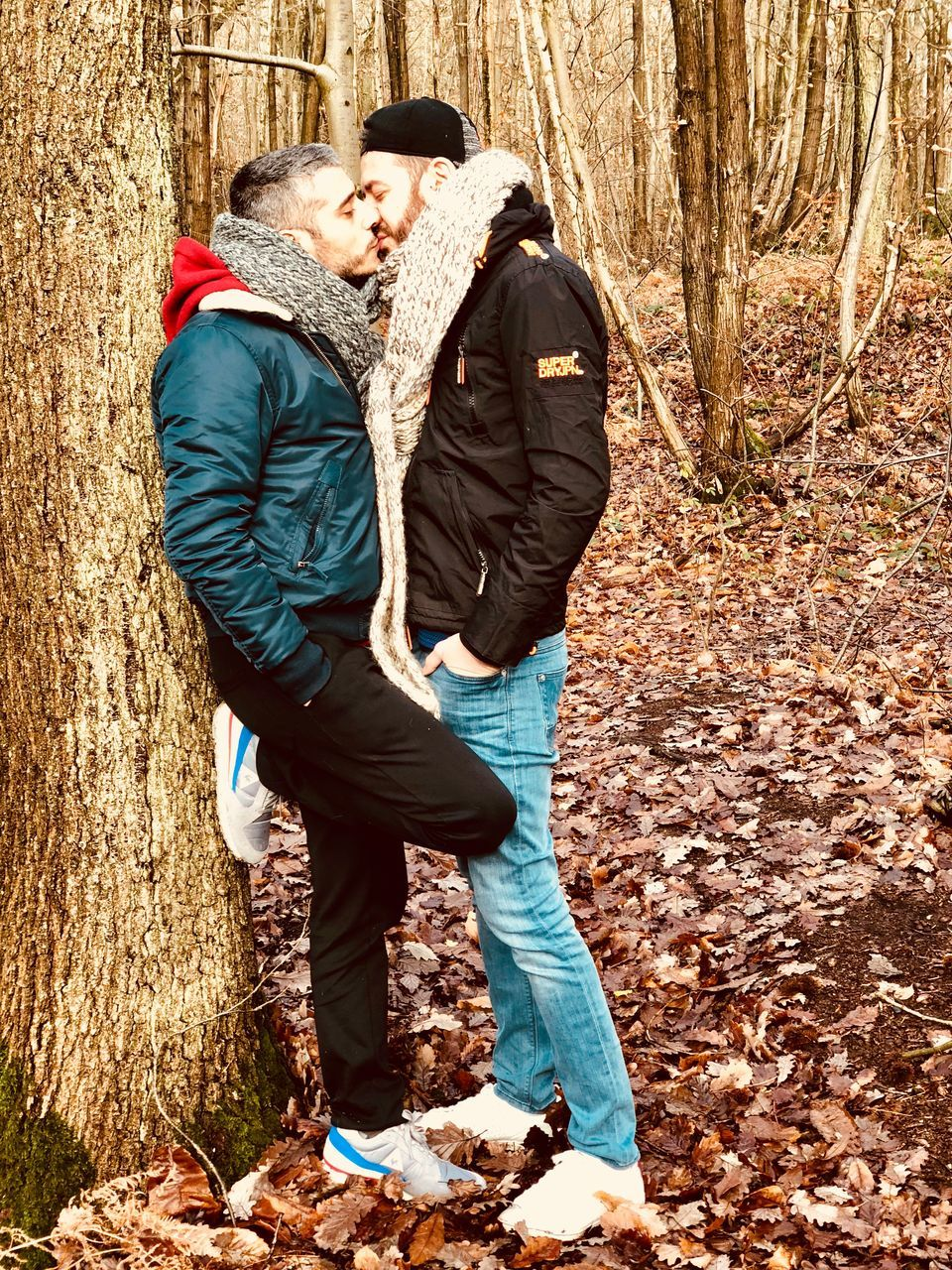 two people, emotion, real people, adult, couple - relationship, love, tree, men, togetherness, positive emotion, women, leisure activity, full length, autumn, tree trunk, lifestyles, nature, trunk, day, casual clothing, warm clothing, outdoors